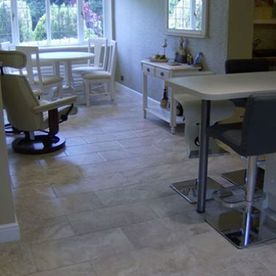 kitchen tiled floor with tables and chairs