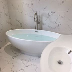 full bath and white tiles.