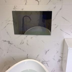 mirror and bathroom tiles