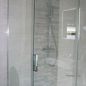closer shot of shower and tiles