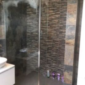 shower and brown tiles