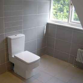 modern bathroom tiles and toilet
