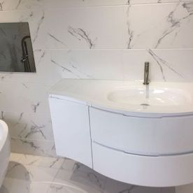 bathroom sink and white tiles