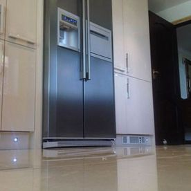 tiled floor and fridge