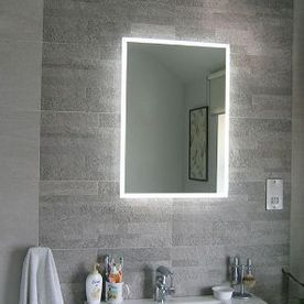 glowing mirror and bathroom tiles
